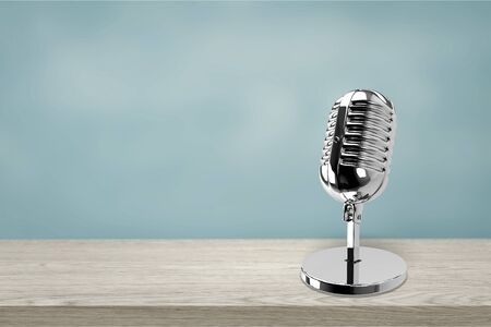 Retro microphone on wooden table vintage stlye