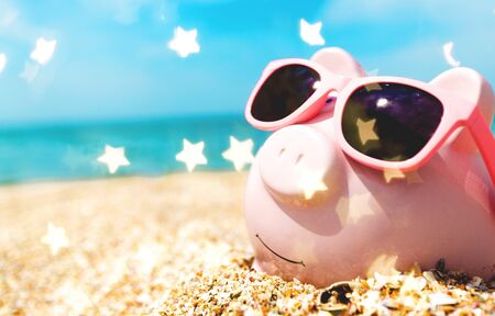 Piggy Bank Wearing Sunglasses Relaxing Stock Photo