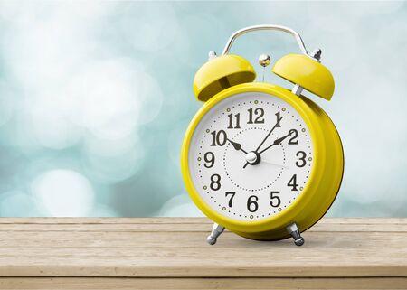 Yellow alarm clock on white backgroundYellow alarm clock on white background