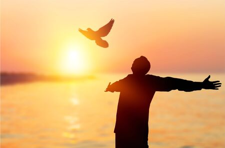 Happy man rise hand on morning view. Christian inspire praise God on good friday background. Now one man self confidence on peak open arms enjoying nature the sun concept world wisdom fun hope 스톡 콘텐츠