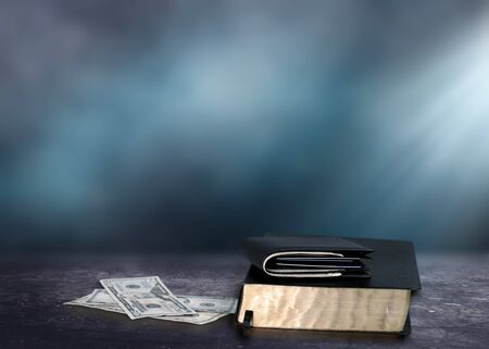 Holy Bible and money with Black wallet Stock Photo