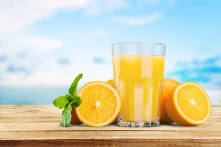 Orange juice and slices of orange on background Imagens - 124705749
