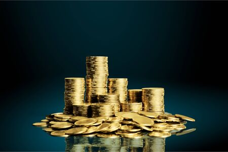 Golden coins stacks on a  background