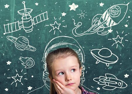 Beautiful girl dreamer about space Stock Photo