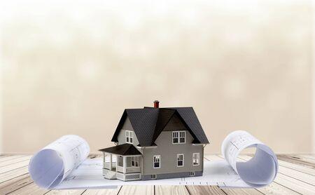 Classic house model on blueprint on white