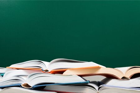 Books are opened and piled together on background Stok Fotoğraf - 124542332