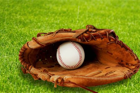 Baseball glove with a ball