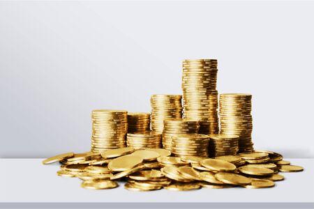Golden coins stacks on a desk