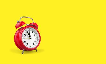 Retro alarm clock on yellow background 写真素材
