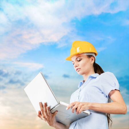 Female engineer on building background