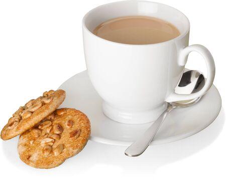 Tasse de café à côté des cookies