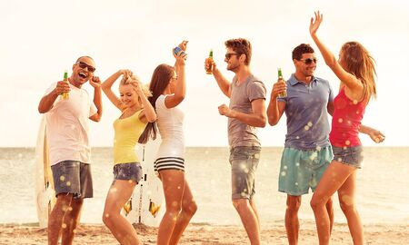 Group of young adults partying at the beach