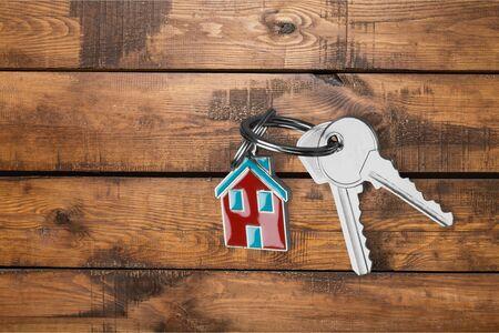 House keys on wooden floor background