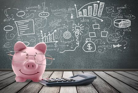 Blue piggy bank in glasses on background Stock Photo