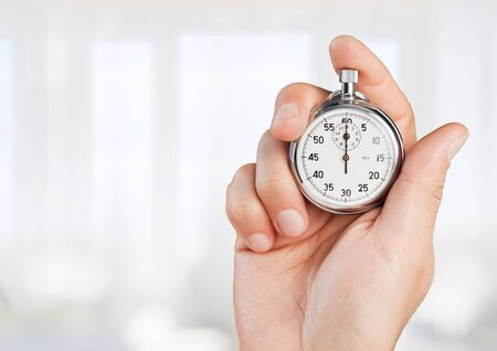 Close-up Stopwatch in Human Hand, Timer Stock Photo
