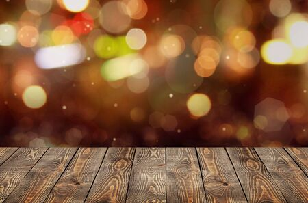 Selective Empty wooden table in front of abstract blurred festive light background with light spots and bokeh for product montage display of product.          - Image