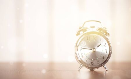 Retro alarm clock on table  background Stock Photo - 125222477