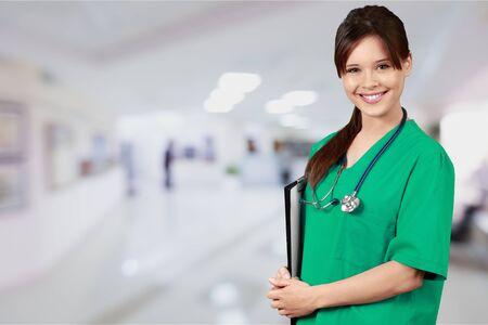 Young nurse woman with stethoscope at hospital Фото со стока