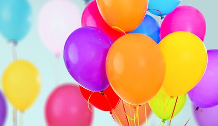 Bunch of colorful balloons on background