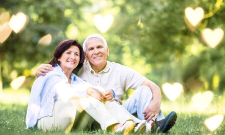 Happy mature couple in the park in summer day Stock Photo