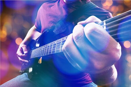 Stage lights.Abstract musical background.Playing guitar and concert