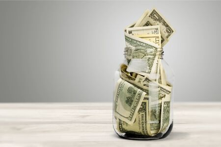 Glass jar for money on background Stock Photo