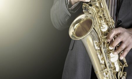 Saxophone player Saxophonist playing jazz music instrument Jazz musician playing sax alto Stock Photo - 124931765