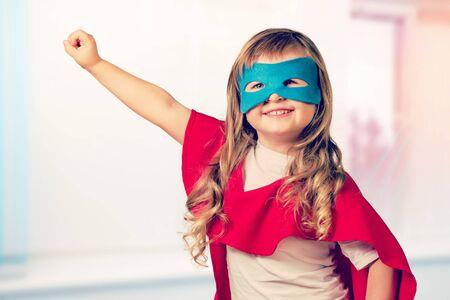 Portrait of beautiful little girl in superhero