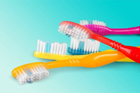 New Colorful Toothbrushes   on  Background