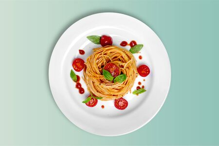 Delicious pasta on white plate on  background