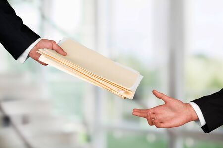Hands of businessmen holding documents on background Stock Photo