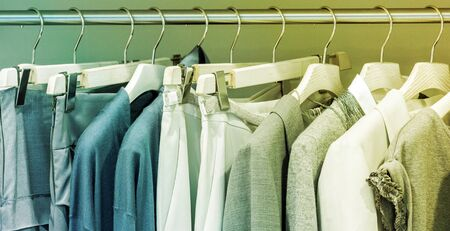 Modern clothes on metal hangers in closet