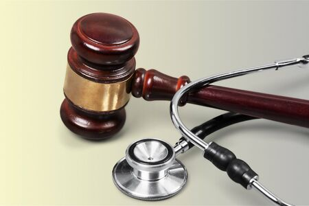 Gavel and stethoscope on background, symbol photo