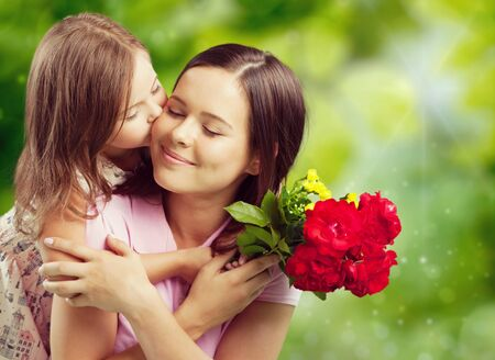 Young woman with little girl and beautiful