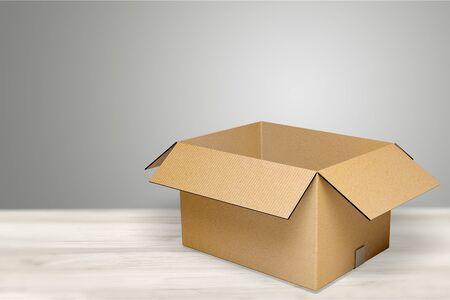 Cardboard box on desk Stock Photo