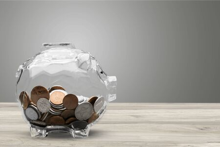 Piggy bank and coins on background