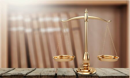 Law scales on table background.