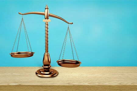 Law scales on table background. Symbol of justice Foto de archivo