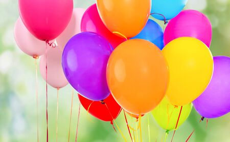 Bunch of colorful balloons on white background