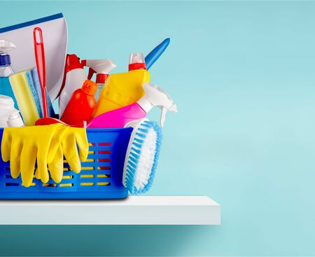 Plastic bottles, cleaning sponges and gloves on