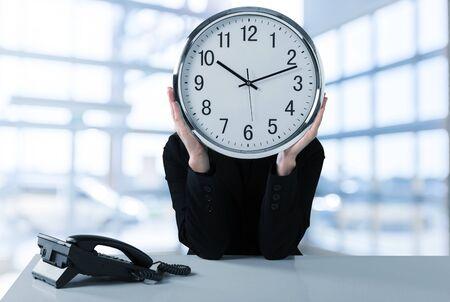 Businessman holding Clock at head, Business Clock Concept Banco de Imagens