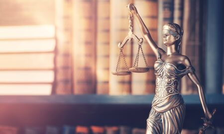 Legal law concept image, Statue of justice on library background Stock Photo
