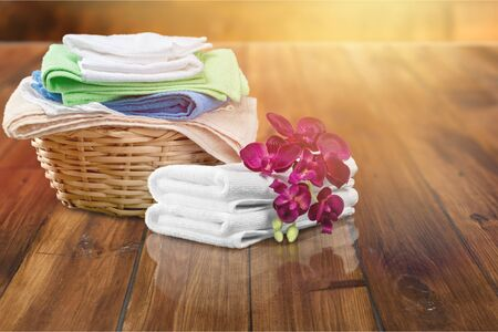Laundry Basket with colorful towels on desk Imagens