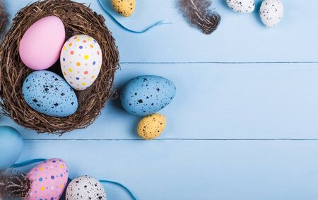 Colorful easter eggs on desk Archivio Fotografico
