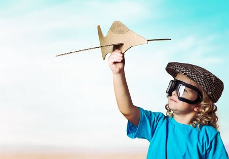 Child plaing with airplane