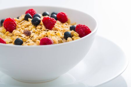 Bowl of Granola, Blueberries and Raspberries