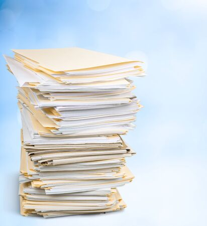 File folders with documents isolated on background