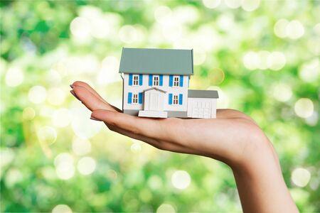 Businessman Holding House Model and Keys, Real Estate Concept