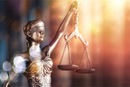 Statue of justice on library background;  courthouse Stock Photo