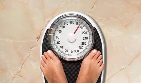 Feet on a bathroom scale - Isolated